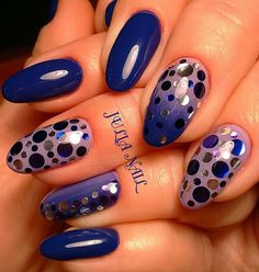 This manicure is blue decorated with large round sequins.