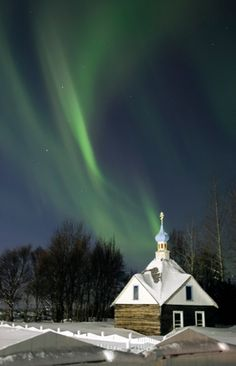The northern lights or aurora borealis above the Russian Orthodox Saint Nicholas Memorial Chapel in Kenai, Alaska. Photo / AP