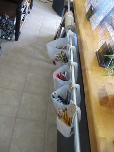 Additional storage for crayons, rolls of paper, etc.