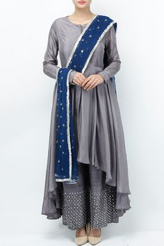 Featuring a grey full sleeved front slit asymmetric flared kurta based in silk. It comes with a pair of solid palazzo pants with sequin and bead work at the bottom. It is paired with a navy net dupatta with floral motifs accented with gota border. Fabric: Silk Care Instructions: Dryclean only. Pakistani Formal Dresses, Indian Dresses, Indian Outfits, Designer Anarkali Dresses, Designer Dresses, Kurta Designs, Blouse Designs, Simple Dresses, Beautiful Dresses