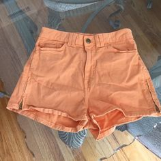 American Apparel High Waisted Shorts, size 26/27 American Apparel high waisted butternut twill shorts with stretch and side zippers in size 26/27. Never worn. Flat lay measures 13 across, 98% cotton, 2% elastan, rise is 10.5 and inseam is 2.25. Please ask if you have any questions. American Apparel Shorts Jean Shorts