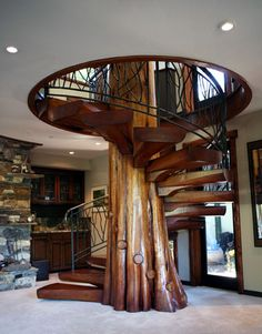 Spiral stairs with tree in center - Love this!