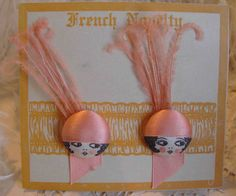 Circa 1920s French flapper face buttons with ostrich feathers on original card