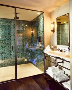 turquoise shower tiles from Soho Home with brass pipe detailing