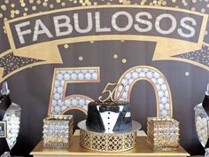 Cake display from a Fabulous 50 Black & Gold Birthday Party via Kara's Party…