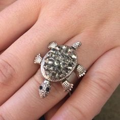 Adjustable Rhinestone Turtle Ring Super cute adjustable rhinestone turtle ring. It is a super adorable gift. The head, tale, and legs all move. Bought from a boutique so it is really original. Willing to negotiate. Jewelry Rings