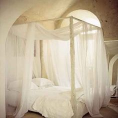 we have a four poster bed like this - it would be so easy to just throw on the fabric!