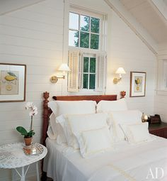 Martha's Vineyard bedroom in a former utility shed with a circa 1840 tiger maple tulip-post bed.