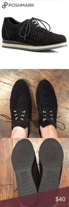 Stuart Weitzman Relay Suede Sneakers in Nero Black These sneakers are in like new condition! They have a basketweave Suede texture. They also have lace-up front with silvertone hooks.  The only flaw is shown on the last picture. These shoes were only tried on but never worn outside. They are comfortable and chic.  These sneakers look expensive and are made with the quality you expect from Stuart Weitzman.  Every design is created with attention to detail by skilled craftsmen in Elda, Spain…