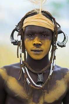 View top-quality stock photos of Mursi Man With Face Painting South Omo Valley. African Tribal Makeup, Tribal African, African Face Paint, Tribal Face Paints, Tribal Paint, Mime Face Paint, Arte Tribal, Tribal People, African Tribes