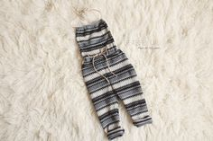 Black and grey patterned romper with twine ties9-12 month size (this can vary)