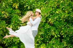 happy couple - happy couple is turned on the background of tropical palm trees
