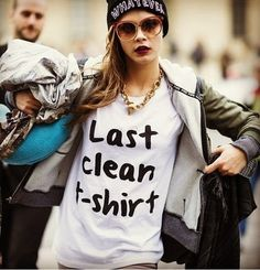 Model Cara Delevingne seen on the street after the Louis Vuitton runway show wearing a Local Heroes T-Shirt during Paris Womens Fashion Week Autumn/Winter 2013 on March 2013 in Paris, France. Cool Tees, Cool T Shirts, Funny Shirts, Tee Shirts, Slogan Tee, Cara Delevingne, Tumblr Shirt, Looks Street Style, Statement Tees
