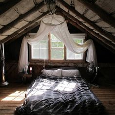 Lots of wood, floor bed with lots of room around it, mosquito netting