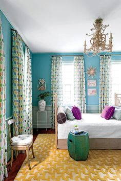 "Double-Duty Den - 10 Colorful Ideas for Small House Design - Southernliving. Select furniture that can work double-duty, like a den that works overtime as a guest room. ""It was very important to me that our guests had a queen bed to sleep in, but our house is so small it had to be a space we could also use,"" explains Lulie. She dreamed up the queen-size daybed by attaching a headboard to each end of a mattress."