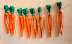 Make an easy carrot garland for Easter this year. It's an easy paper craft for kids to make at Easter.