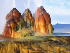 Fly Geyser was accidentally created when scalding water began erupting through a man-made well in 1964. Dissolved minerals developed the mount and terraces that now surround the geyser, which continues to grow and release water up to five feet in the air. And as for those alien-like colors? You can thank algae for that.
