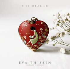 The Reader. Beautiful hand made polymer clay necklace. Would love to own this! love the intricate detail!