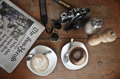 Words, cappuccino and coffee (and camera, salt and pepper).