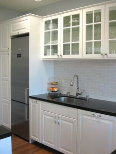 """Completely remodeled black and white kitchen 