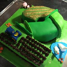 Jaxson's 2nd birthday cake, party at wroxham barns so went for a farm theme!! Not going to lie I was in tears making this cake until my hubby made the hedges which bought the whole cake together. Super happy with this one!! :))