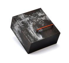 Vorm van muziekbox??  Julia Turner Brooch, 2009. Wood, stain, paint, vitreous enamel, steel. 1 x 1 x .5 in (2.5 x 2.5 x 1.3 cm).