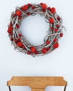 Glue lush scarlet eggs to a silvery grape-wood wreath to create a crisp, welcoming image.