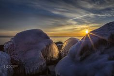 Before the Ice Melts - It was 10°C today, so the ice here may have melted.  This was taken at sunrise a few days ago on the shores of Lake Ontario, by Karen Cunningham... #Sunrise #Canal #Hamilton #Ice #Icy #LakeOntario #Morning #Nature #Rocks #Sky