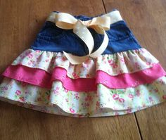 Repurposed jeans into a ruffled skirt. Yellow cotton and salmon eyelet  with a pretty yellow polka dot belt. Size 4T $20