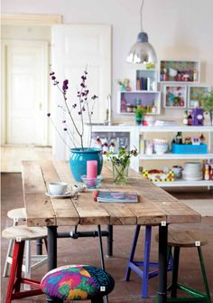 i want a table like this!!! (Love the different colour stools!)