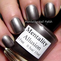 Mentality Nail Polish - Allusion, a blackened brown metallic creme nail polish, dries to a satin finish.