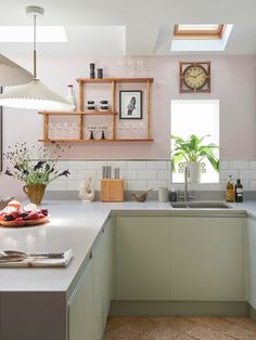 This colorful London apartment has the cutest pink and green kitchen. | House Tours by Apartment Therapy #kitchens #modernkitchen #pinkkitchen #kitchenideas #greenkitchen #moderndecor #modern #colorfuldecor #minimalistdecor #london #londonapartments #openshelving Open Plan Kitchen, Kitchen Dining, Kitchen Decor, Kitchen Interior, Kitchen Ideas, Dining Room, Green Headboard, Dark Green Walls, London Apartment