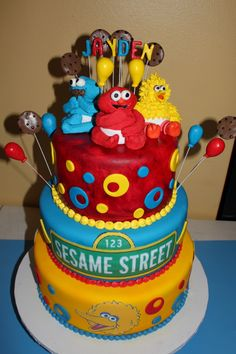 Baby Sesame Street Birthday Cake. Like I could ever make this cake but it sure is cute.