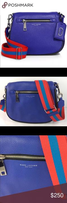 """🎉HOST PICK!!! 🎊 Marc Jacobs Gotham Saddlebag ⭐️ 🎉Host Pick for Best In Bags Party! 🎉 Beautiful blue Marc Jacobs Gotham Saddlebag / crossbody bag with colorful 18-26"""" adjustable (removable) strap! The bag is 12""""x9""""x5"""" and I would call it large. Silver hardware with """"Marc Jacobs"""" on the zipper pulls and a luggage tag with silver 'double J' logo. 100% authentic Marc Jacobs! Retails for $450. The first photo is a """"stock"""" photo. The last photo is also """"stock"""" for size and style reference, all…"""