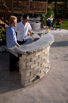 Stone Oasis Curved Bar creates an entertaining setting for family and friends.