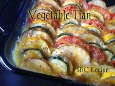 Vegetable Tian Ingredients: 2 medium potatoes (any kind) 1 medium yellow zucchini 1 medium green zucchini 3 medium tomatoes 1 medium yellow onion 1 cup of cheese (your choice) 3 cloves garlic 1 tbs…