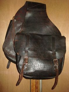 "Vintage Brown Leather Motorcycle Saddle Bags | eBay     Use it stage a ""Larry Hagman-style"" photo with bubbly."