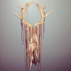 Abstract modern dream catcher made with real leather, feathers, and a beautiful full deer antler rack from a Michigan Whitetail. Circle circumference