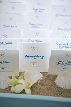 beach wedding place cards...like the idea of using the shell as a photo holder