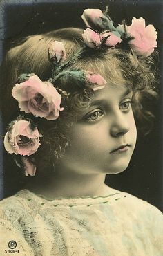 Vintage Postcard of a little Victorian girl with a halo headband of huge pink flowers.