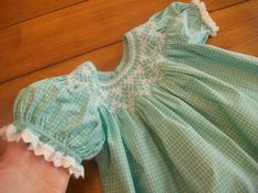 .Love this dress...the smocking looks like lace.