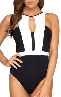 JETS Swimwear High Neck One Piece Swimsuit | Raw-luxe design with futuristic influence, this new season one-piece swimsuit commands attention with a high neckline and cut-out detailing. Embrace the art of noir et blanc for a look that comes served with timeless poise.