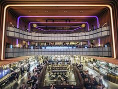 A shuttered movie theater in Madrid, Spain, has been transformed into a glittering multi-level food court and dazzling nightlife destination.
