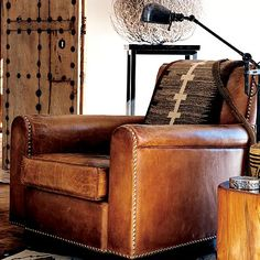 Love the old doors and the destressed leather chair by Ralph Lauren Joshua Tree Room Scene