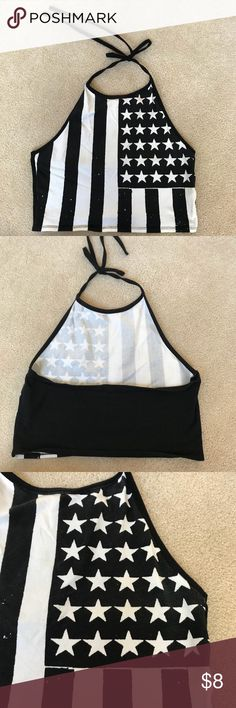 Black and White Flag Halter Crop Black and White Flag Halter Crop Size large. In great condition, only worn once. This is a Knut material that is black and white with a flag in the background and splatter dots for detail. Great fit and love the halter look! Tops Crop Tops
