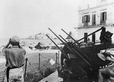 A German 2cm FlaKvierling anti-aircraft gun in action, Acitrezza, Catania, 1943.