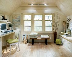 Cape cod style attic converted into an office.