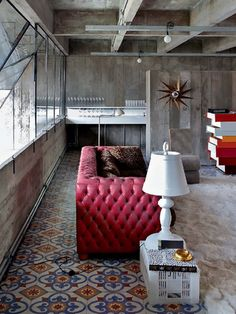 Chesterfield contrast with morrocan tiles and a crate side table