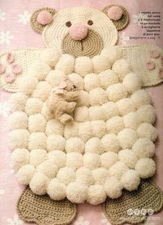 I can't read this pattern but I can use the picture and figure it out. Doesn't look hard, just crochet circles and pom poms.