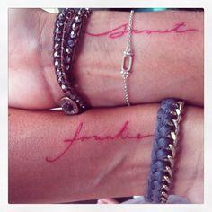 Fine script tattoo in red with my kiddies names. Wrist tattoo